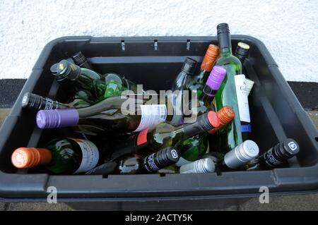 Aberystwyth Ceredigion/UK December 3 2019:  Kerbside glass jar and bottle recycling containers used for weekly glass recycling in Ceredigion, Wales - Stock Photo