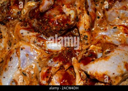 Chicken wings marinated with spices fried in a pan. Home cooking. - Stock Photo