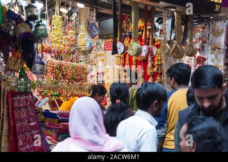 Woman shopping in Chandni Chowk Shop in Old Delhi India - Stock Photo