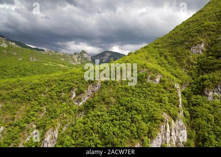 Mountains in heavy clouds in Bosnia and Herzegovina - Stock Photo