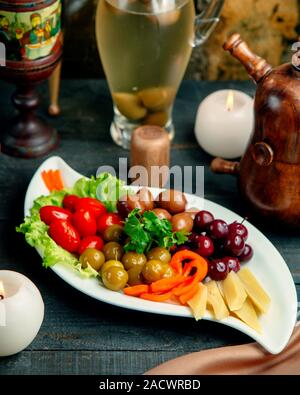 various selection of pickles on plate - Stock Photo