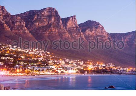 The Twelve Apostles loom over Camps Bay, near Cape Town, South Africa