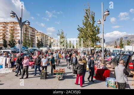 Fuengirola, Spain. Stall and people strolling on weekly Flea Market, second hand market in Fuengirola, Costa del sol, Spain. - Stock Photo