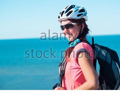 Woman sitting om rock over sea landscape - Stock Photo