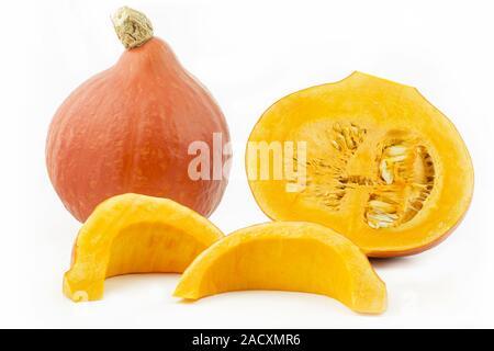 Whole Hokaido pumpkin and pieces, optional - Stock Photo