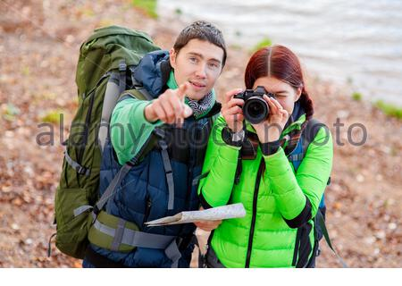 woman on hiking trip with man - Stock Photo