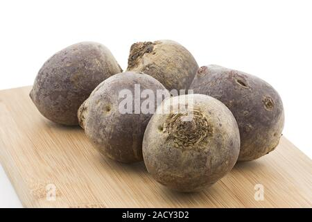 Whole beetroot on wooden boards - Stock Photo