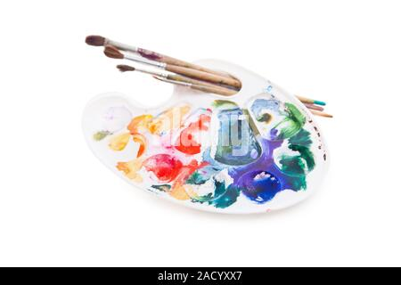 Heavy used artist#39;s palette with brushes - Stock Photo
