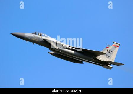 LEEUWARDEN, NETHERLANDS - APR 19, 2018: US Air Force F-15 Eagle fighter jet aircraft from the Massachusetts Air National Guard taking off during exerc - Stock Photo