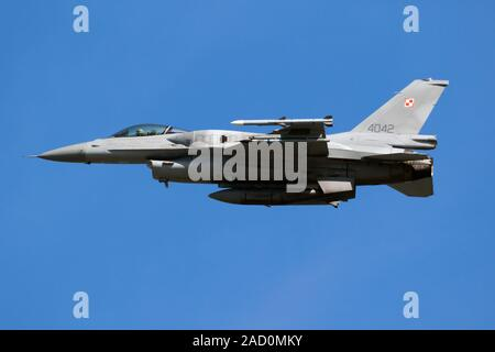 LEEUWARDEN, THE NETHERLANDS - APR 19, 2018: Polish Air Force F-16C Fighting Falcon fighter jet in flight over Leeuwarden airbase during military exerc - Stock Photo