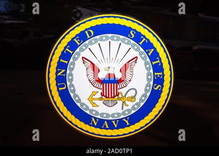 San Diego, Navy pier, California, UNITED STATES - August 3, 2018: Emblem of the United States Navy isolated on a door of black car of United States - Stock Photo