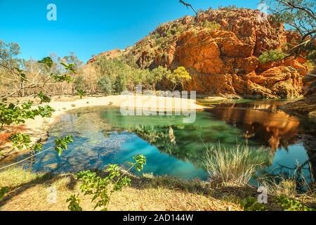 Aerial view of Ellery Creek Big Hole waterhole fed by West MacDonnell Ranges and surrounded by red cliffs. Starting point for Sections 6 and 7 of - Stock Photo