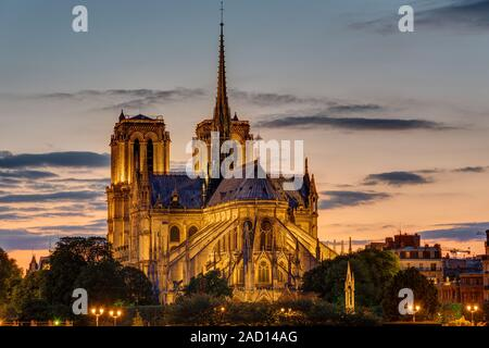 The backside of the famous Notre Dame cathedral in Paris at dawn - Stock Photo