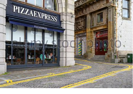 Pizza Express Restaurant Front Window Lit Up At Night
