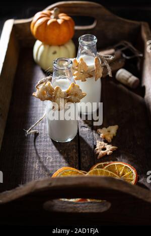 Homemade cookies hung on milk bottles.Sweet dessert.Winter decoration.Healthy food - Stock Photo