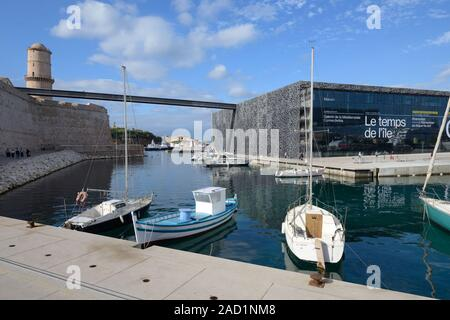 New Port with Fishing Boats & Modern MUCEM Museum, designed by Rudy Ricciotti (2013) & (to left) Fort Saint Jean at Ent to Vieux Port Marseille France - Stock Photo