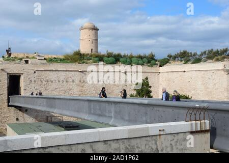 Tourists Crossing Modern Footbridge or Aerial Walkway which links Panier District with Fort Saint Jean, part of the MUCEM Museum, Marseille  France - Stock Photo