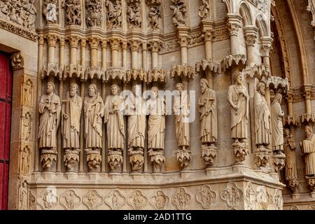 Detail of the stone carving of saints apostles in the arch entrance t the Cathedral Notre Dame d'Amiens, Picardy, France - Stock Photo