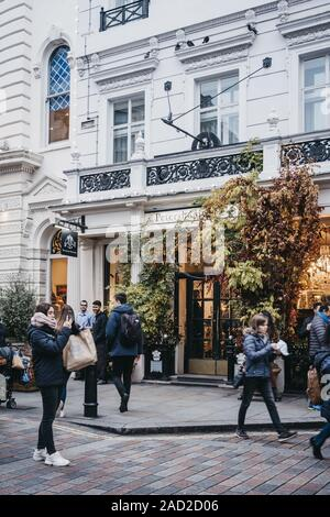 London, UK - November 24, 2019: Facade of Petersham Nurseries in Covent Garden, London, people walk past. Covent Garden is a famous tourist area in Lo - Stock Photo