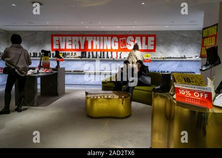The Barneys store on Seventh Avenue in New York is festooned with signs informing loyal fans that the store is liquidating, seen on Saturday, November 23, 2019. The iconic fashion outposts were sold to B. Riley Financial, liquidation specialists, while the intellectual property went to Authentic Brands Group. (© Richard B. Levine) - Stock Photo