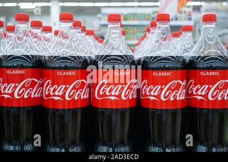 Tyumen, Russia-August 27, 2019: Plastic bottles of Coca Cola on display on Coca Cola stand during. Coca Cola Company is leading soda drinks manufactur - Stock Photo