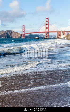 The Golden Gate bridge as seen from Baker Beach on the Pacific Ocean side of the entrance to San Fransisco Bay, San Fransisco, California, USA. - Stock Photo