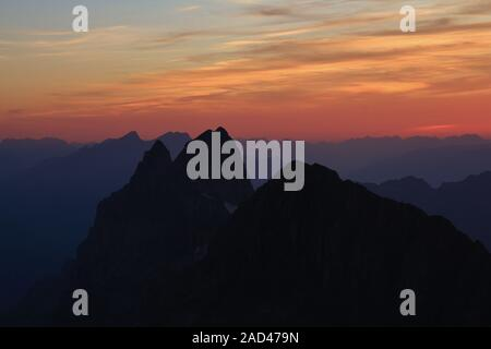 Colorful sunset in the Swiss Alps, view from mount Titlis. - Stock Photo