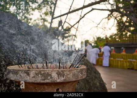 Incense burning at a Poya (full moon) festival in Unawatuna, Sri Lanka - Stock Photo