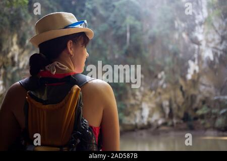 Woman in hat among mountains - Stock Photo