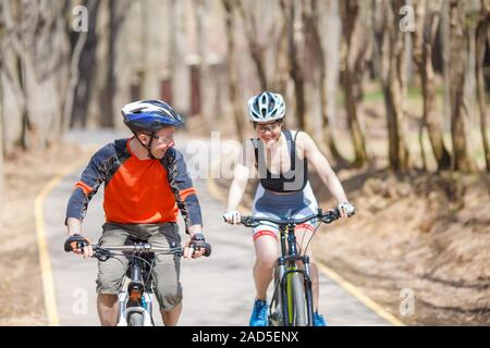 Athletes in helmets on bicycles - Stock Photo