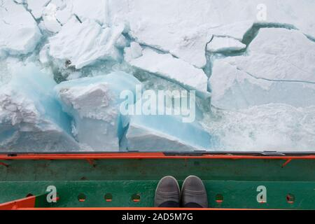 Russia, High Arctic, 89 degrees north as seen from 50 Years of Victory icebreaker. View of shoes on deck overlooking crashing through ice.