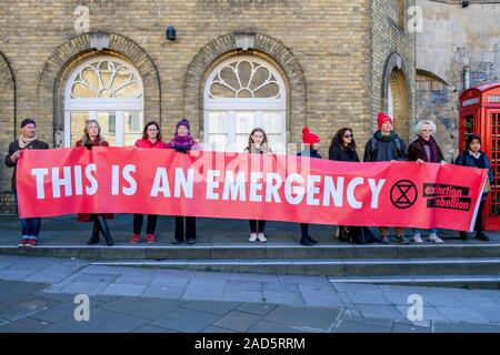 Banner carrying Extinction Rebellion protesters are pictured as they join students + school children in a climate change protest march Bath 29-11-19 - Stock Photo
