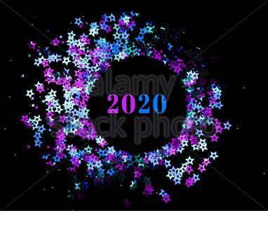 Top view of round frame made of colorful holographic stars confetti on black background. Festive and holiday concept. Copy space. - Stock Photo
