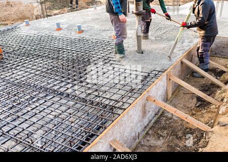 pouring concrete slab - Stock Photo