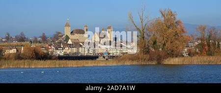 Medieval castle and church in Rapperswil, St Gallen canton, Switzerland. Blue lake Obersee. Autumn scene. - Stock Photo