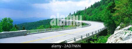 Landscape with view of Linn Cove Viaduct on mountainside, North Carolina, USA - Stock Photo