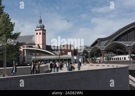 tourists and locals walking  in front of the main train station in cologne, germany - Stock Photo
