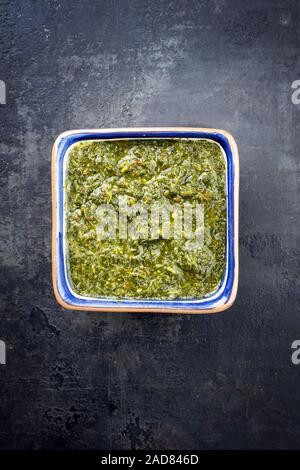 Traditional Columbian chimichurri sauce aji criollo with chili - Stock Photo