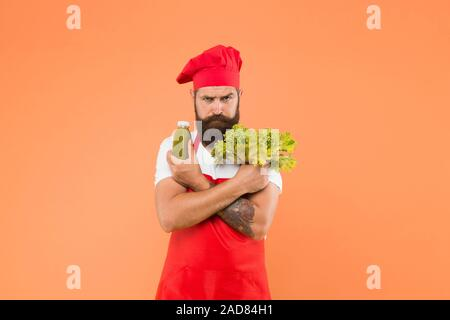 vegetarian lifestyle. raw healthy food concept. organic eco vegan products. bearded man chef in apron and hat. healthy eating and dieting concept. cook hold fresh and blended salad smoothie. - Stock Photo