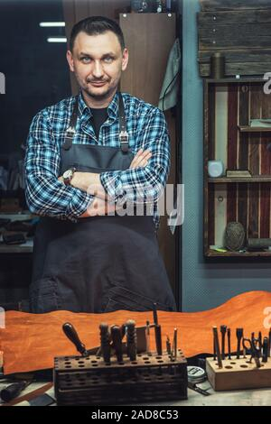 Concept of handmade craft production of leather goods. - Stock Photo
