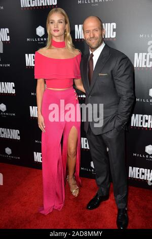 LOS ANGELES, CA. August 22, 2016: Actor Jason Statham & girlfriend actress/model Rosie Huntington-Whiteley at the Los Angeles premiere of 'Mechanic: Resurrection' at the Arclight Theatre, Hollywood. © 2016 Paul Smith / Featureflash - Stock Photo