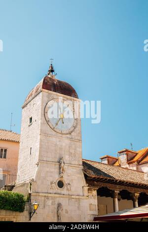 Clock tower and old town square in Trogir, Croatia - Stock Photo