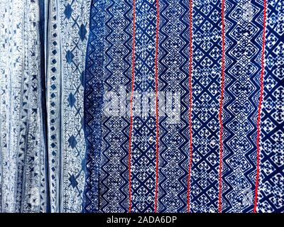 Hmong batik fabric pattern  background. Vintage Hmong Batik Textiles. Traditional style fabric from hill tribe in Thailand. - Stock Photo