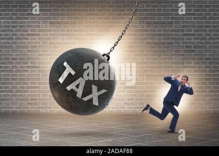 Businessman running away from high taxes - Stock Photo