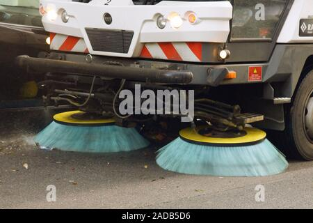 Process of cleaning street with a modern cleaning machine on the streets of a big city in Europe - Stock Photo