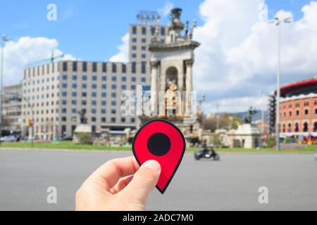 BARCELONA, SPAIN - APRIL 12, 2018: Closeup of the hand of a young caucasian man with a red marker in the Placa de Espanya square - Stock Photo