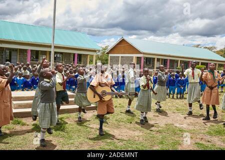 Pupils saying goodbye on the last day, Mirisa-Academy, Nakuru, Kenya - Stock Photo
