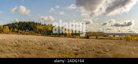 Autumn landscape in Karelia with a field, houses and lakes.  Karelia, Russia. 06.10, 2019. - Stock Photo