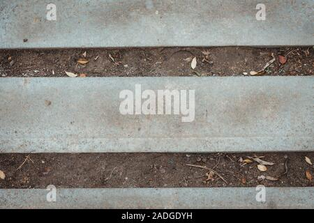 Nature and civilization interaction Background texture. Stone, asphalt, concrete horizontal stripes and dry empty ground. Copy space text. Gray color industrial backdrop. Old surface parallel lines. - Stock Photo