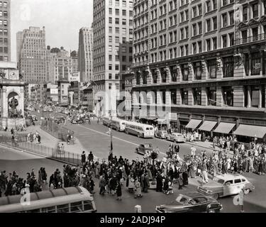 1940s 1950s HERALD  SQUARE INTERSECTION 34TH BROADWAY AND AVENUE OF THE AMERICAS  LOOKING NORTH MANHATTAN NYC NEW YORK USA - r2838 PRC001 HARS TRANSPORTATION B&W DREAMS MIDTOWN STRUCTURE HIGH ANGLE INTERSECTION PROPERTY MOTOR VEHICLE AND AUTOS EXCITEMENT EXTERIOR OPPORTUNITY NYC REAL ESTATE NEW YORK STRUCTURES AUTOMOBILES CITIES VEHICLES EDIFICE NEW YORK CITY 34TH AMERICAS BROADWAY BUSES COOPERATION HERALD TAXIS TRANSIT BLACK AND WHITE CABS CROSSWALK MOTOR VEHICLES OLD FASHIONED - Stock Photo